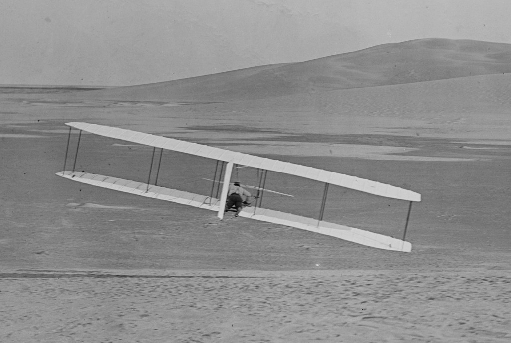 Wilbur Wright demonstrates a controlled turn on a glider at Kitty Hawk - 1902