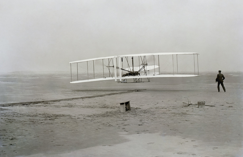 The First Controlled Powered Air Flight - Orville at controls, Wilbur alongside December 17,1903