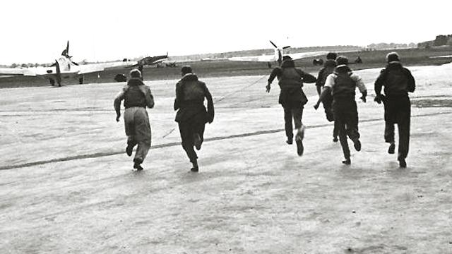 RAF pilots sprint to their planes to attempt to intercept incoming German air attack squadrons in the Battle of Britain 1940